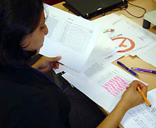 a teacher marking a student work sample